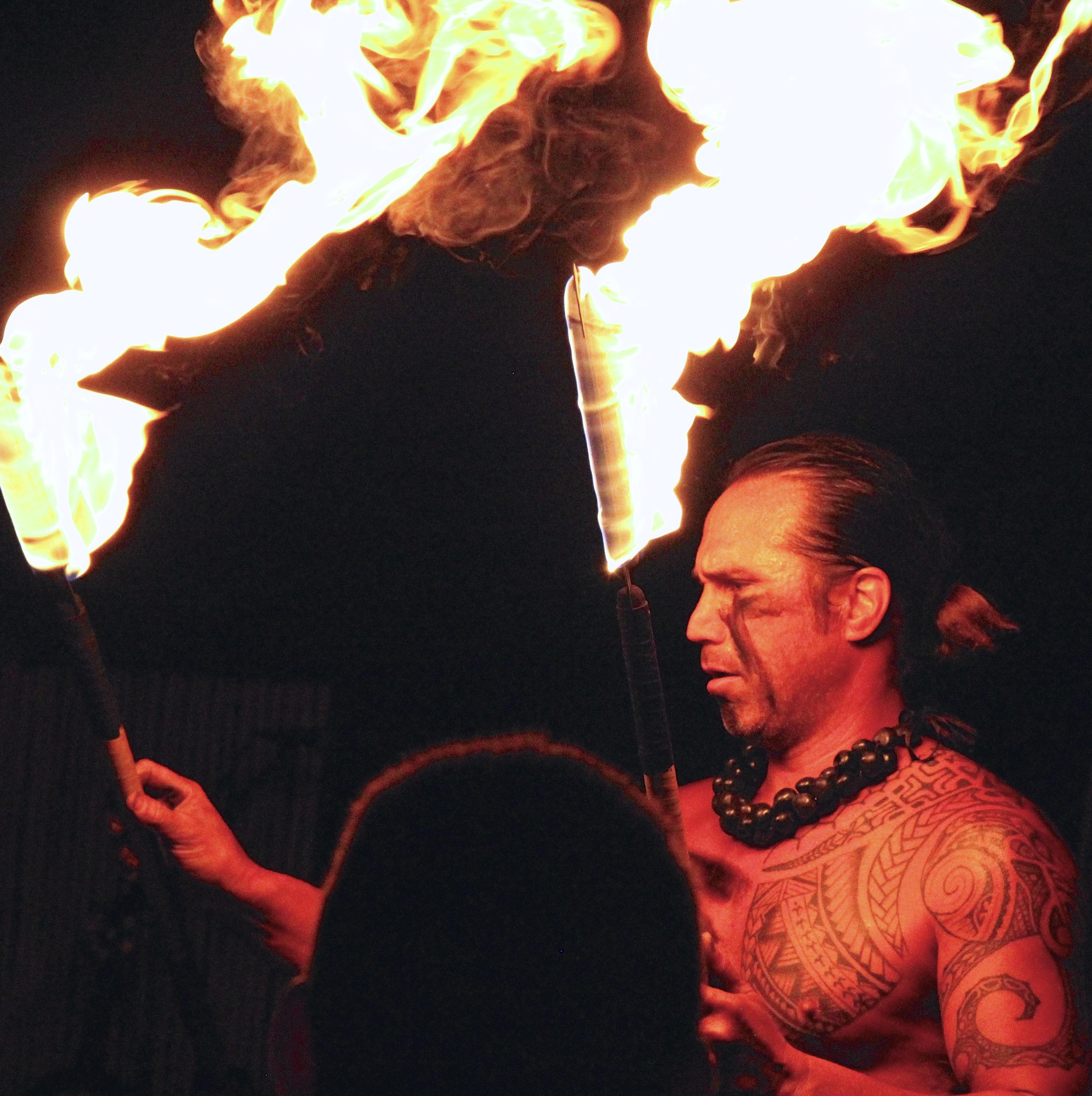 Fire dancer at Mauna Kea Luau. Photo Credit: Tom Wilmer