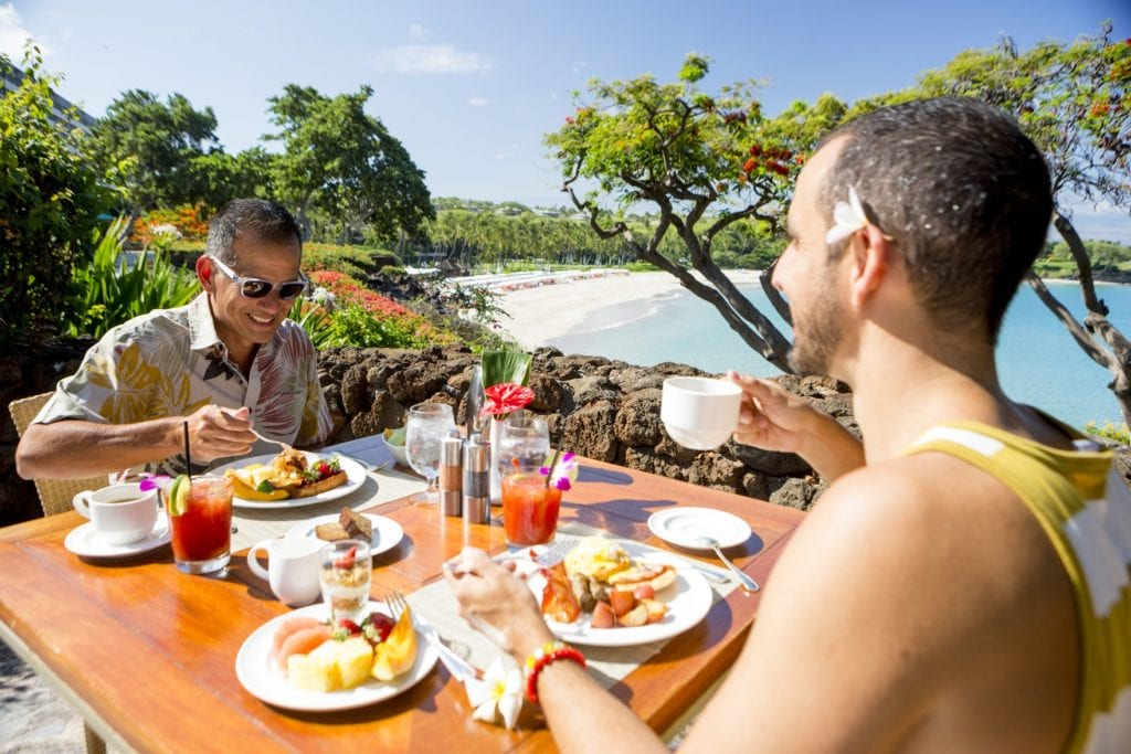 An LGBT couple enjoys brunch at Manta Restaurant at Mauna Kea Beach Hotel on the Big Island, Hawaii. zachstovall.com